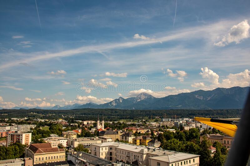 Panorama of the city of Villach with historical churches and a castle in front of the mountains of the Karawanken Mountains in the. Austrian Alps,Europe stock photos