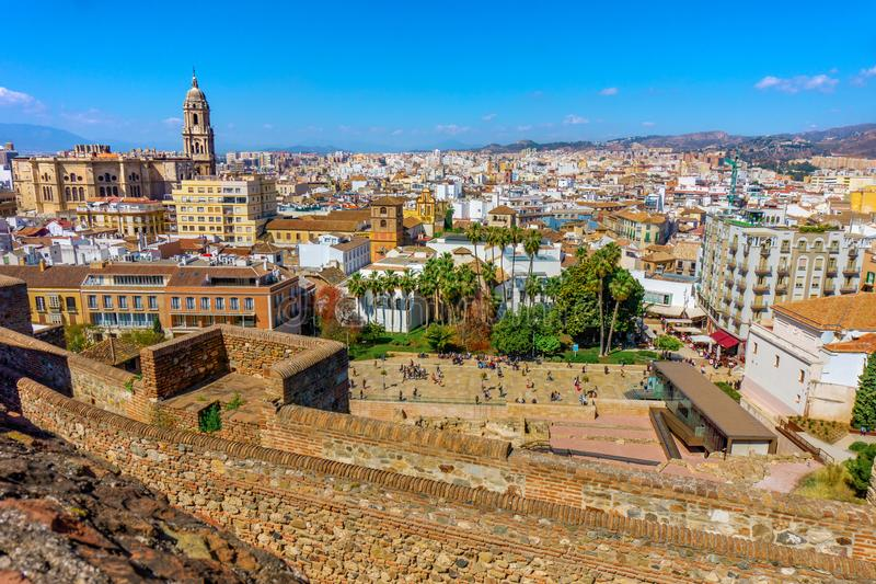Panorama cityscape aerial view of Malaga, Spain. Santa Iglesia Cathedral Basilica of Lady of Incarnation from the Alcazaba castle. And tourists on the street stock photos