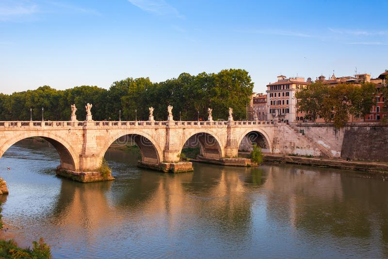 Panorama cityscape from the ancient embankment Tiber in Roma at sunset. Near of bridge and castle of Angels. Saint Angelo castle royalty free stock photo