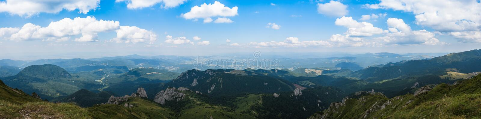 Panorama of Ciucas Mountains, Romania, a sunny summer day, blue sky and beautiful clouds royalty free stock image