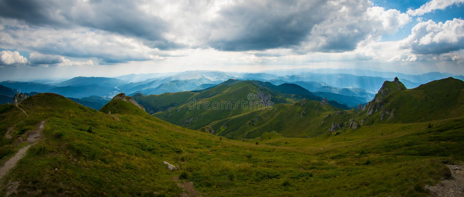 Panorama of Ciucas Mountains, Romania, a sunny summer day, blue sky and beautiful clouds royalty free stock photo