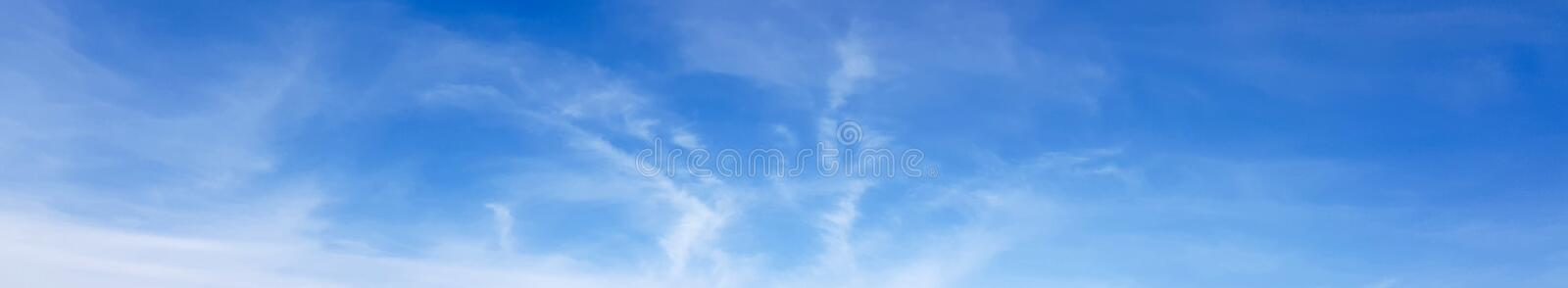 Panorama of clear blue sky with white cloud background. Clearing day and Good weather in the morning stock photo