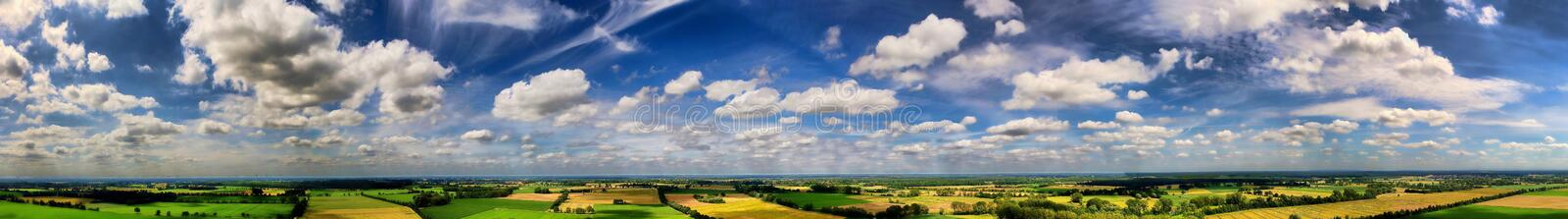 Panorama with clouds of overcast skies about a fields and meadows royalty free stock photos