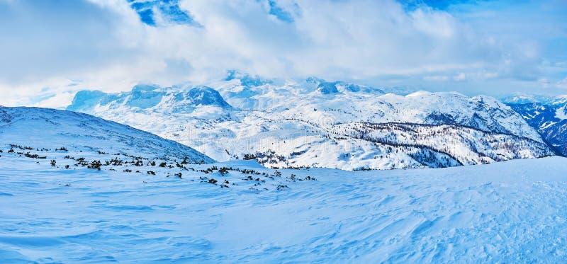 Panorama of cloudy Dachstein mountains, Salzkammergut, Austria royalty free stock photos