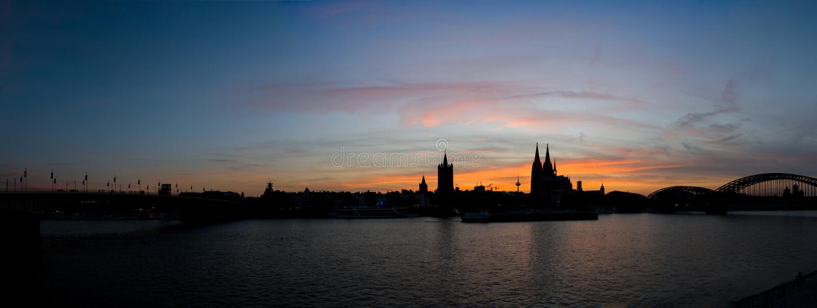 Panorama of Cologne skyline silhouette at sunset with colorful sky royalty free stock photo