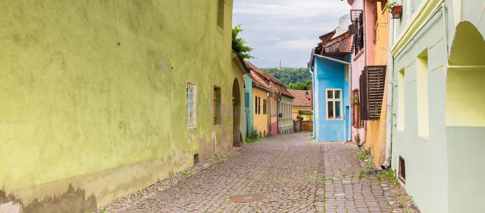 Panorama of a colorful cobblestoned street in Sighisoara royalty free stock photo