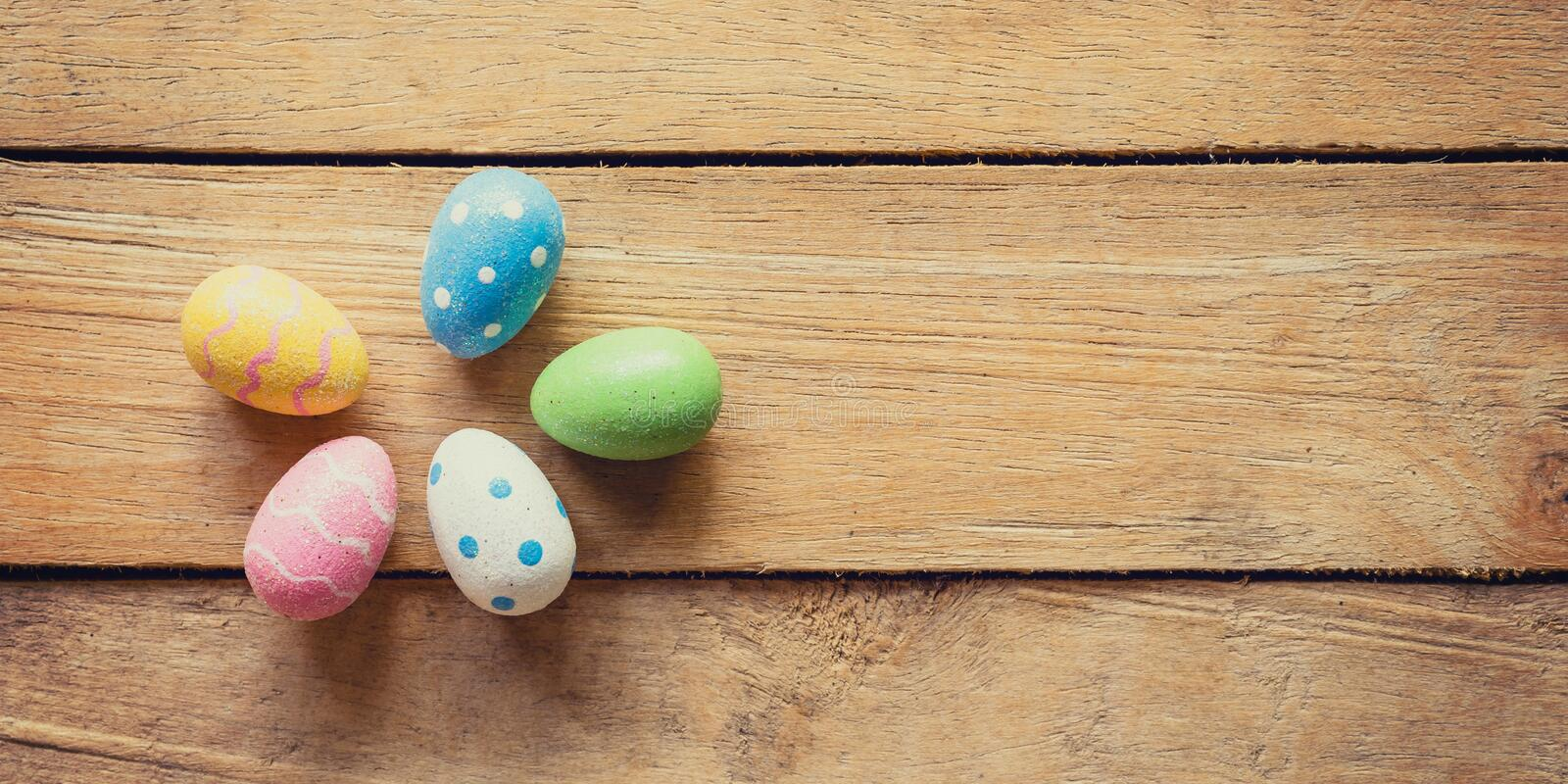 Panorama colorful easter egg group on wood background and texture with copy space stock photography