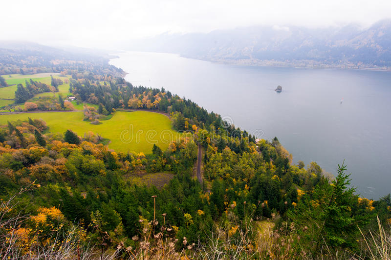 Panorama on Columbia River in Columbia Gorge in fog. Panorama landscape with a bird's-eye view of the site at Columbia Gorge with autumn trees, green meadows stock photography