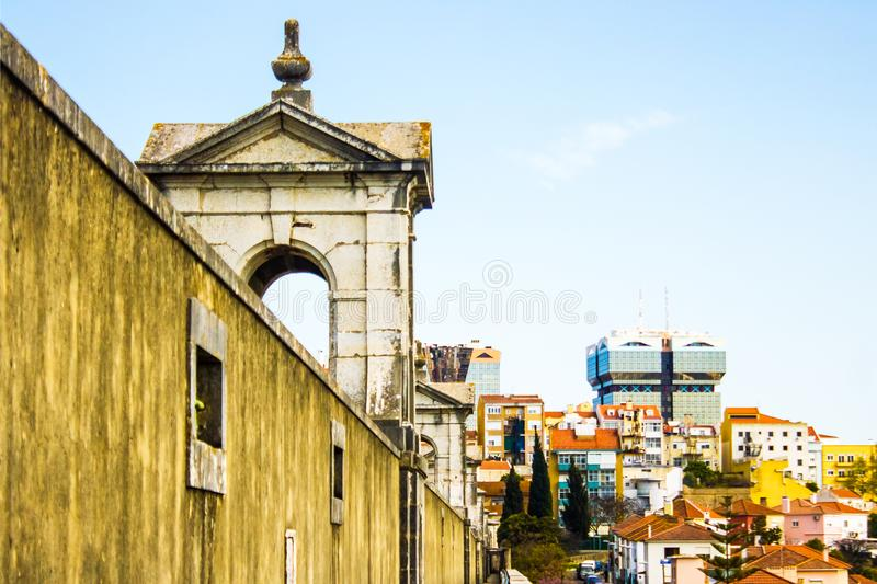 Lisboa, Lisbon, Portugal: contrast between the old and the modern. Panorama of contrasts in Lisboa, Lisbon, Portugal. In the foreground, the walls and the arches stock image