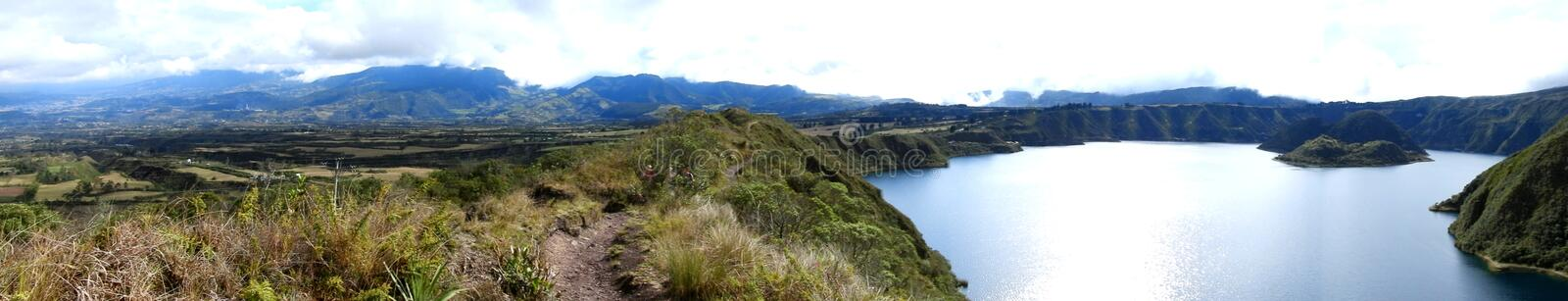 Panorama of Cotacachi crater lake, Ecuador. Panoramic view of a Hiking trail in the Cotacachi Cayapas nature park in Ecuador, South America. Ecological reserve royalty free stock images