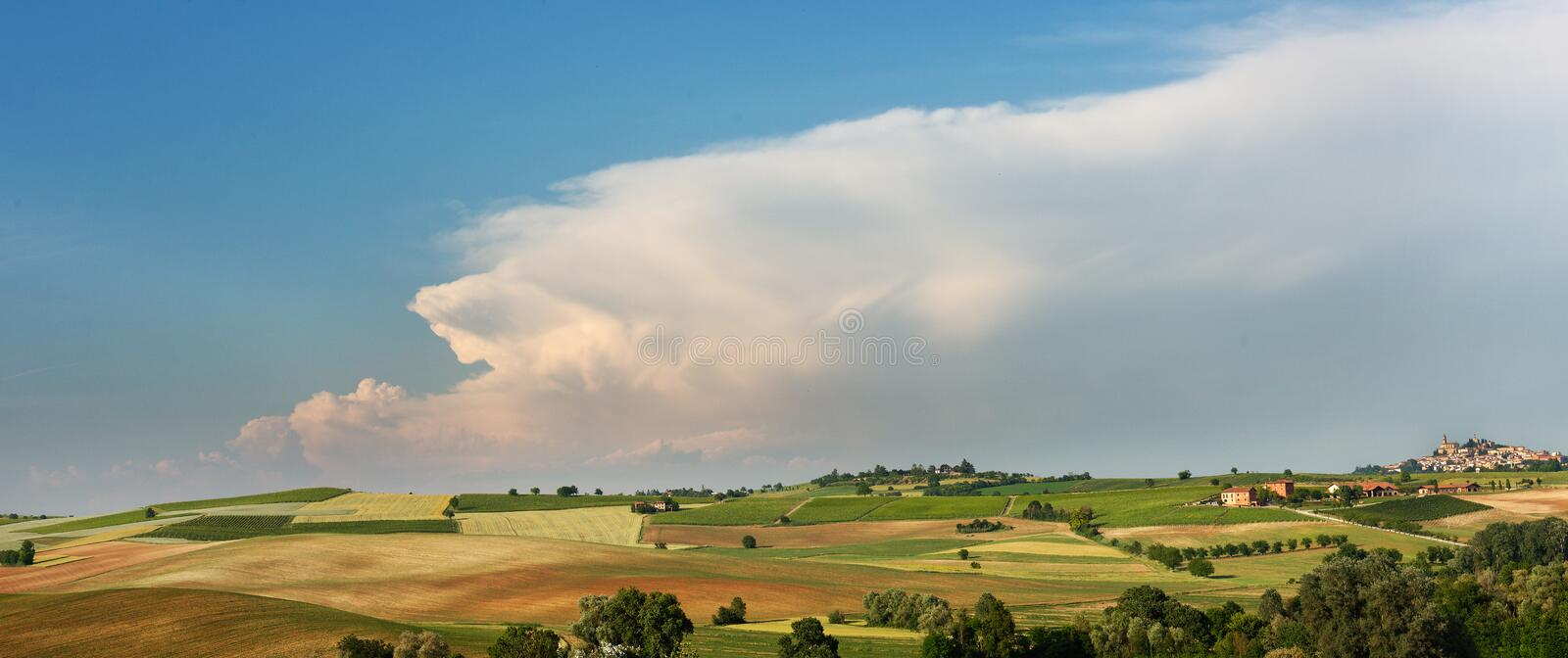 Summer country landscape in Monferrato, Piemonte, near Moncalvo, fields, hills and clouds stock photos