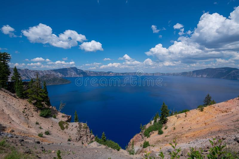 Panorama of Crater Lake near the Rim Village overlook. Beautiful blue Crater Lake panorama near Rim Village stock photography