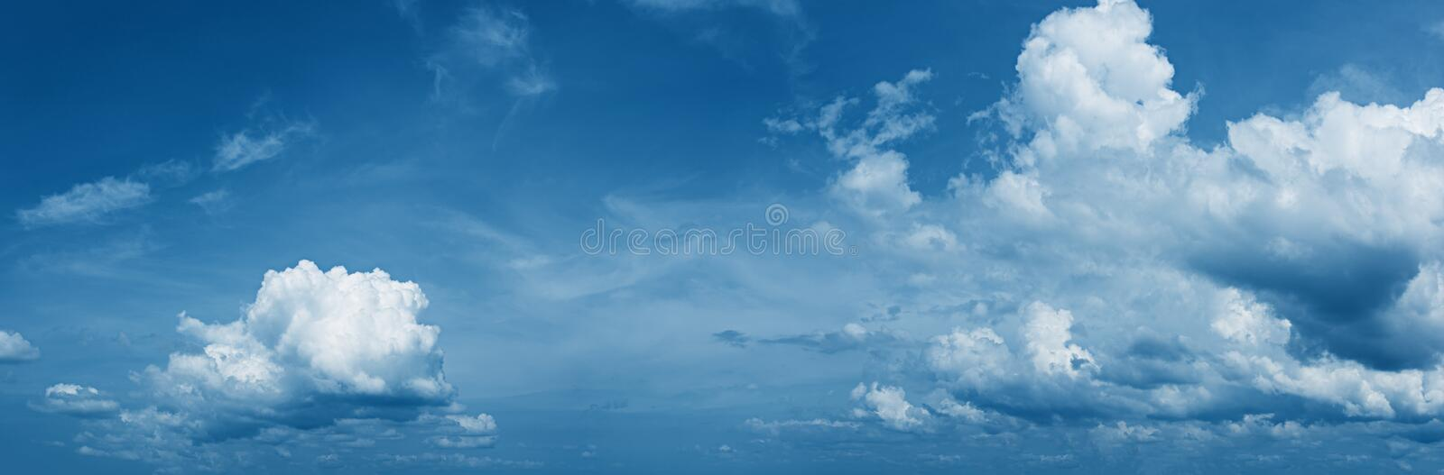 Panorama of daytime sky with beautiful clouds. Panorama of the daytime sky with beautiful clouds royalty free stock photo