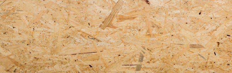 Panorama des gepressten Holzverkleidungshintergrundes - Beschaffenheit der OSB-Platte - OSB-Holzbeschaffenheit lizenzfreie stockfotografie