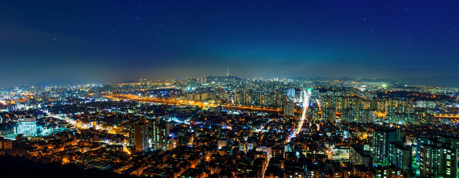 Panorama of downtown cityscape and Seoul tower in Seoul, Korea. Panorama of downtown cityscape and Seoul tower in Seoul, South Korea royalty free stock photo