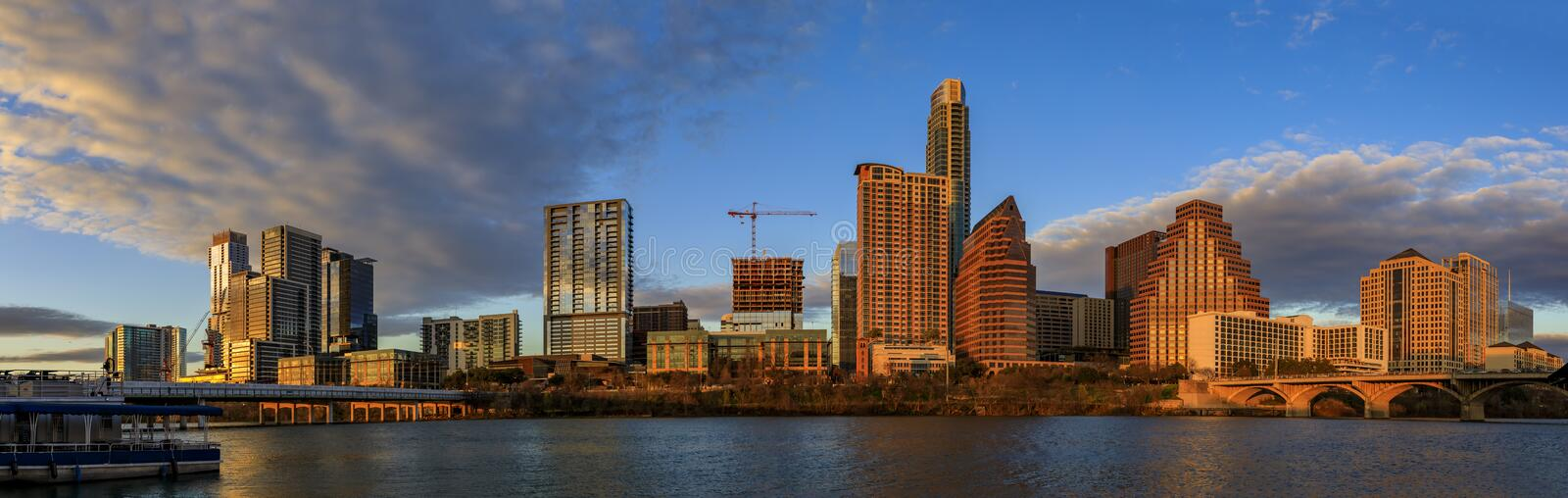 Panorama with downtown view across Lady Bird Lake or Town Lake on Colorado River at sunset golden hour, Austin Texas USA. Panorama with downtown high-rises stock photos