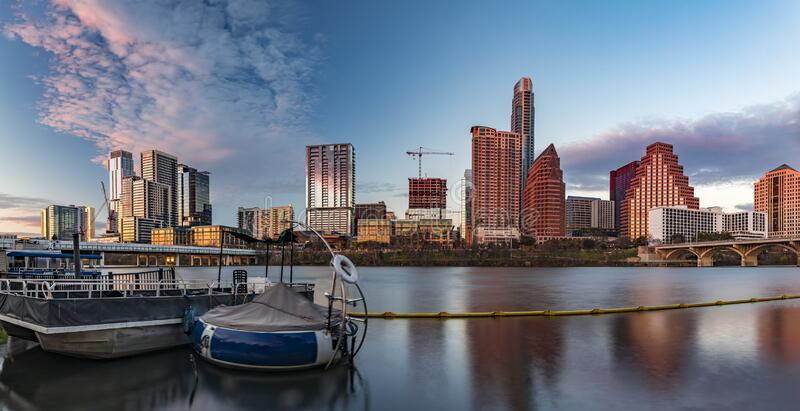 Panorama with downtown view across Lady Bird Lake or Town Lake on Colorado River at sunset golden hour, Austin Texas USA. Panorama with downtown high-rises stock images