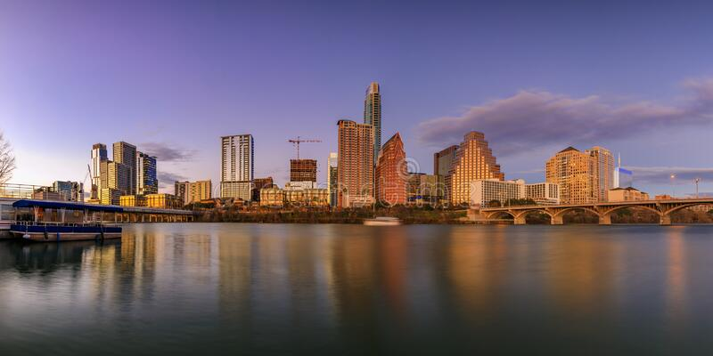 Panorama with downtown view across Lady Bird Lake or Town Lake on Colorado River at sunset golden hour, Austin Texas USA. Panorama with downtown high-rises stock photo