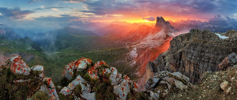 Panorama dramatic sunset in dolomites alp mountain from peak Nuvolau.  stock photos