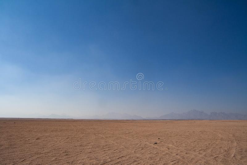 Mountains in the mist on the horizon stock photography