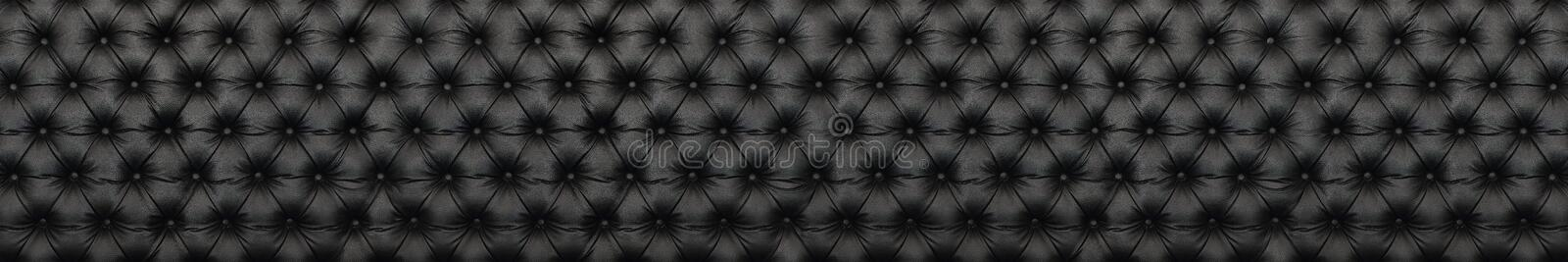panorama of elegant black leather texture with buttons for pattern and background royalty free stock photos