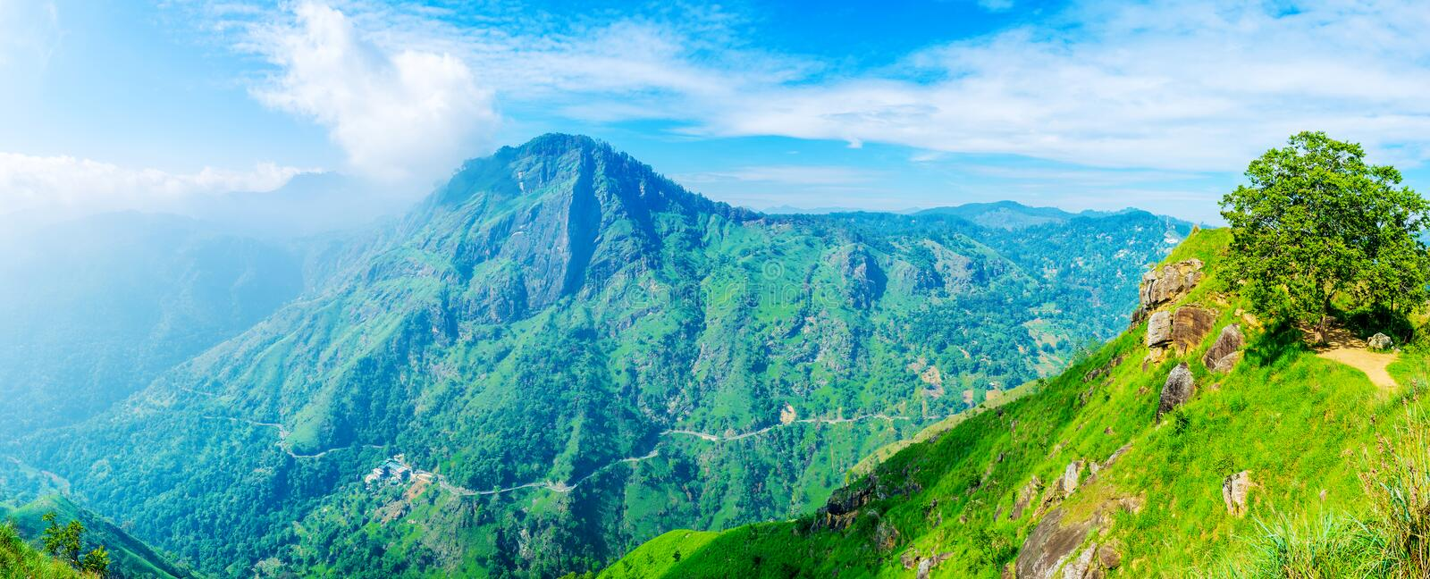 Panorama of Ella highlands. The mountain resort is famous for its high peaks of Ella Rock, Little Adam`s Peak and picturesque Ella Gap, Sri Lanka royalty free stock photo