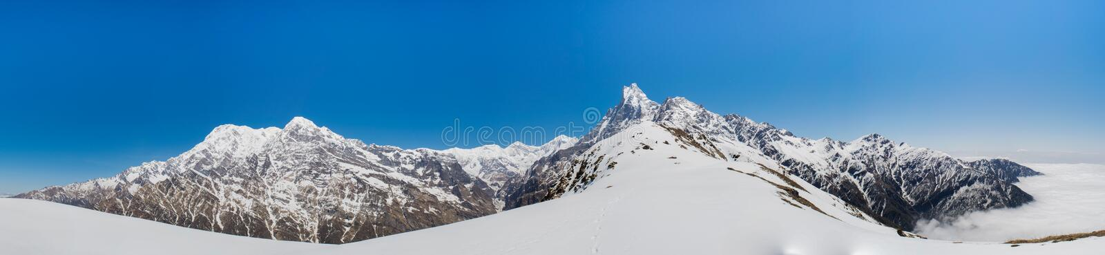 Panorama epic landscape view of beautiful Himalaya mountains covered with snow at Mardi Himal trekking area. In Nepal stock photos
