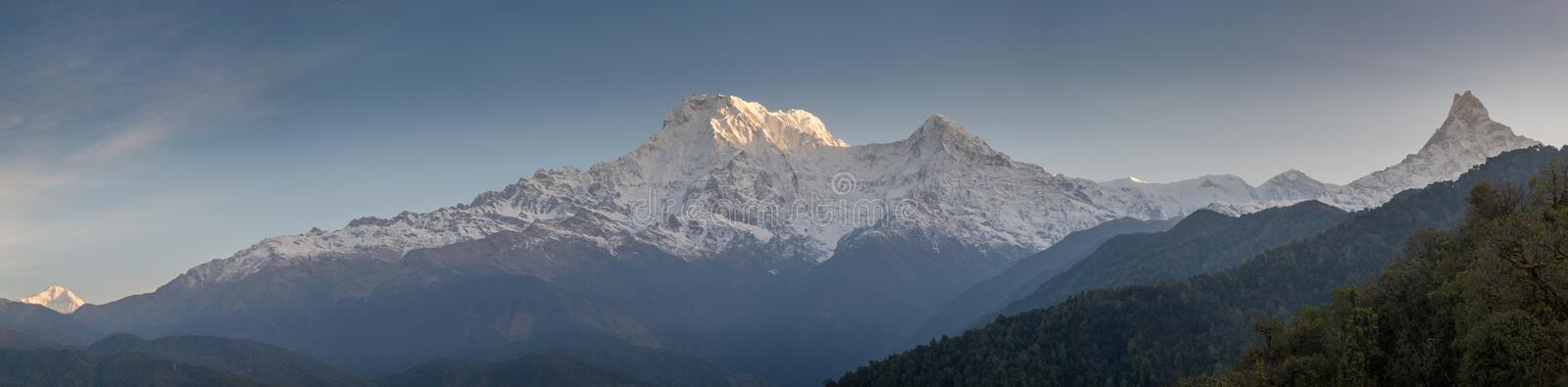 Panorama epic landscape view of beautiful Himalaya mountains covered with snow at Mardi Himal trekking area during sunrise. In Nepal royalty free stock photo