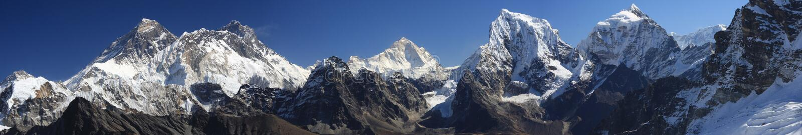 Panorama of Everest. Panoramic photo of Everest and other mountains from the Renjo Pass. Gokyo region, Nepal stock image