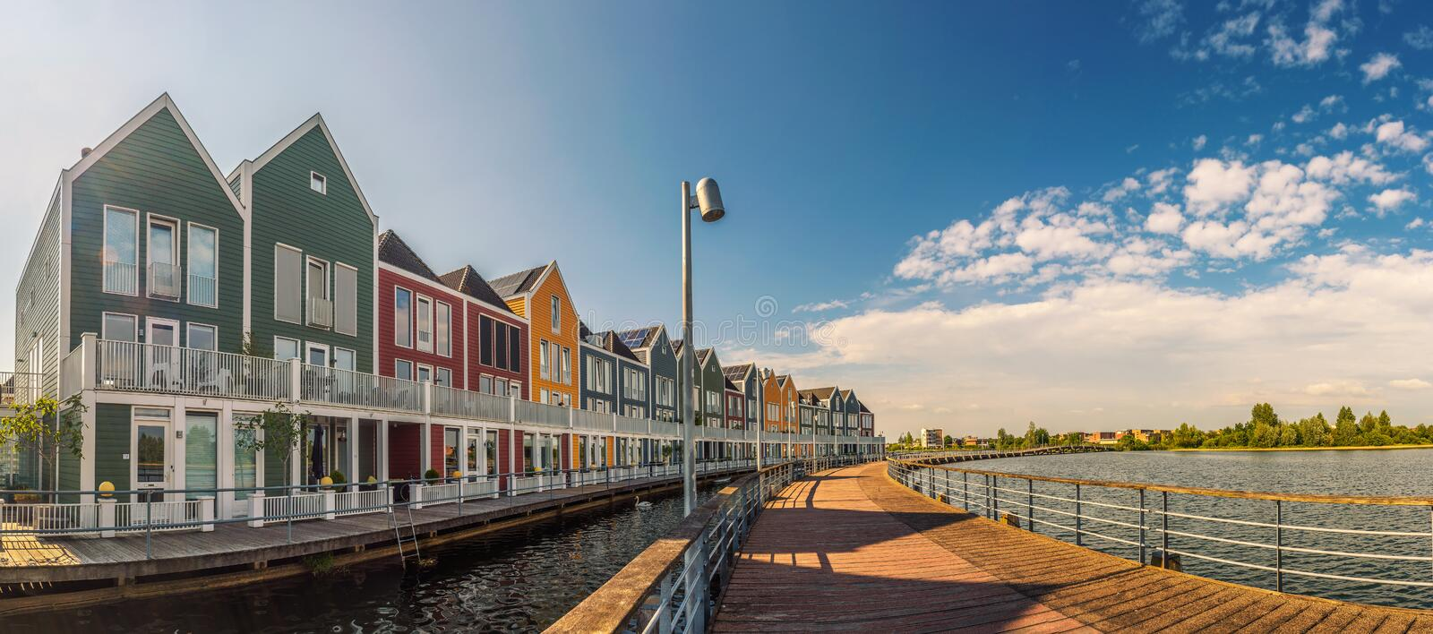 Panorama of famous Rainbow Houses in Houten, Netherlands. Panorama of famous Rainbow Houses facing Rietplas lake in Houten, Netherlands stock photos