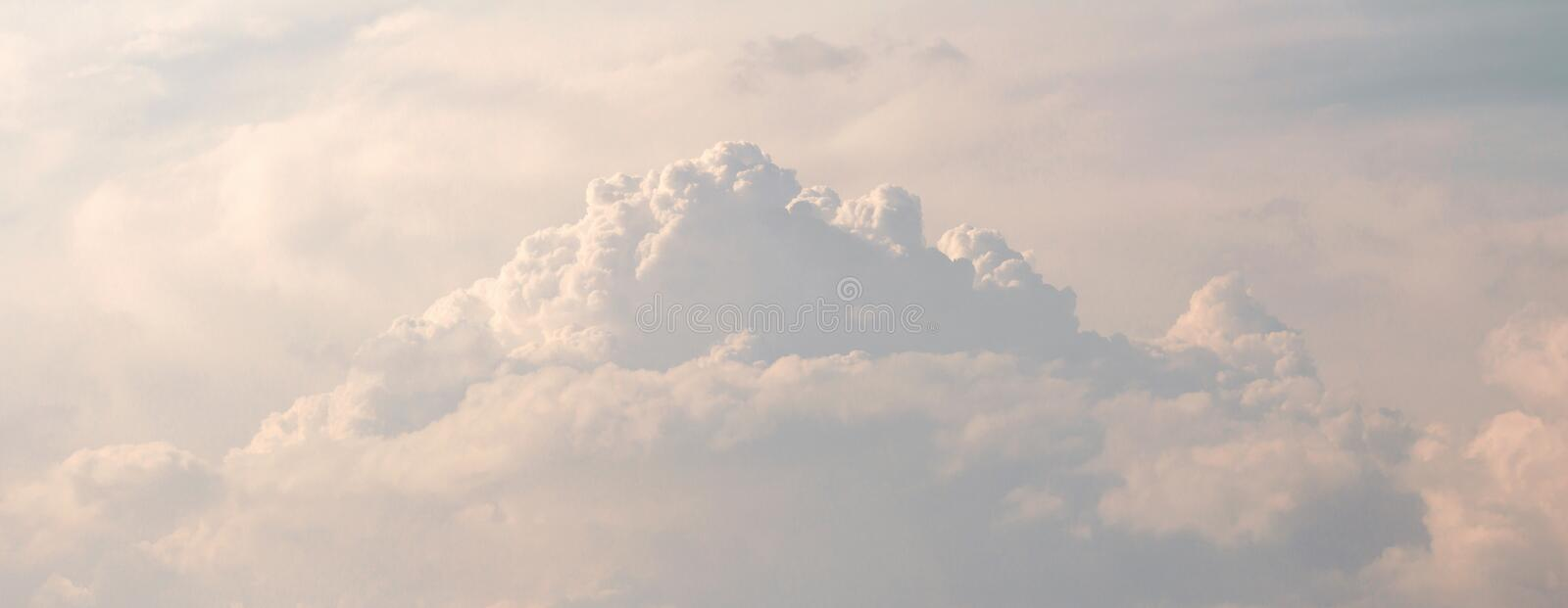 Panorama fluffy storm clouds before heavy rain. Fluffy storm clouds before heavy rain and wind. soft sky panorama royalty free stock image