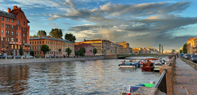 Panorama of the Fontanka river embankment in St. Petersburg at sunset stock image