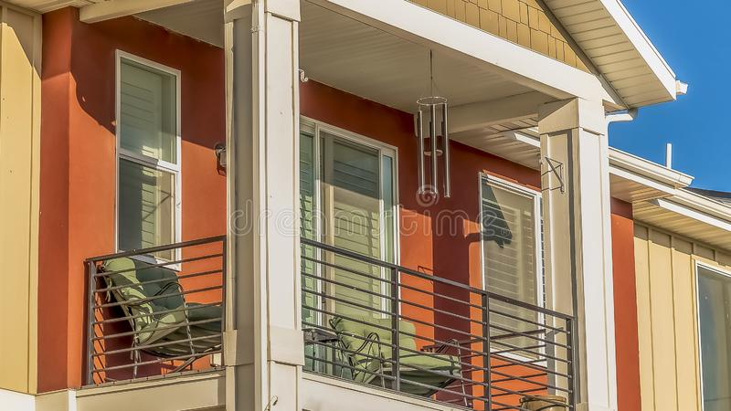 Panorama frame Close up of the small balcony of a home against clear blue sky on a sunny day royalty free stock photos