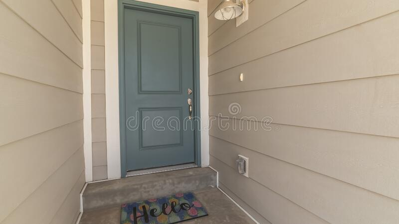 Panorama frame Recessed covered front door with Hello welcome mat royalty free stock photography