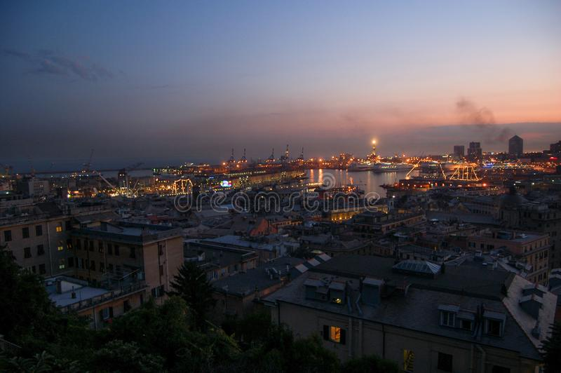 Panorama of Genoa. By night, Italy royalty free stock photography