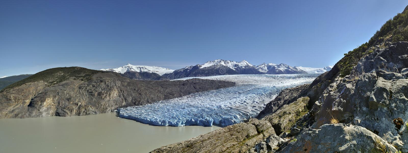 Panorama gigantesque de glacier sous le ciel ensoleillé bleu, Torres del Paine, Chili image libre de droits