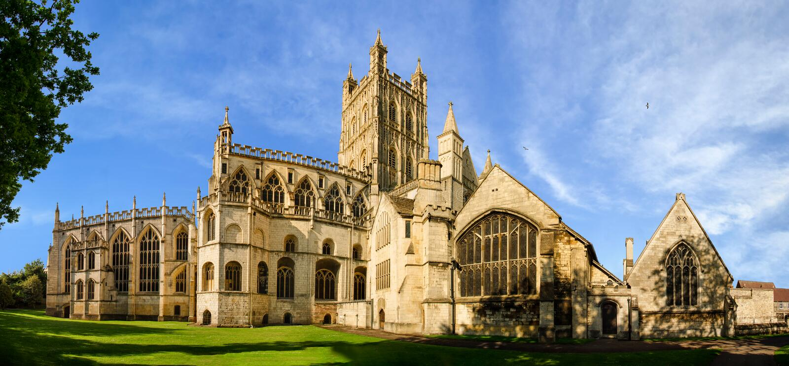 Panorama of Gloucester Cathedral. Panoramic view of Gloucester Cathedral Church of St Peter and the Holy and Indivisible Trinity on a sunny day royalty free stock images