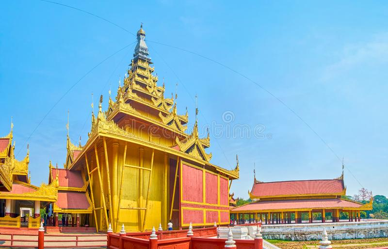 The panorama of Golden Spire in Mandalay Palace, Myanmar. MANDALAY, MYANMAR - FEBRUARY 23, 2018: The high Golden Spire dominates over the Royal Palace, was built stock photos