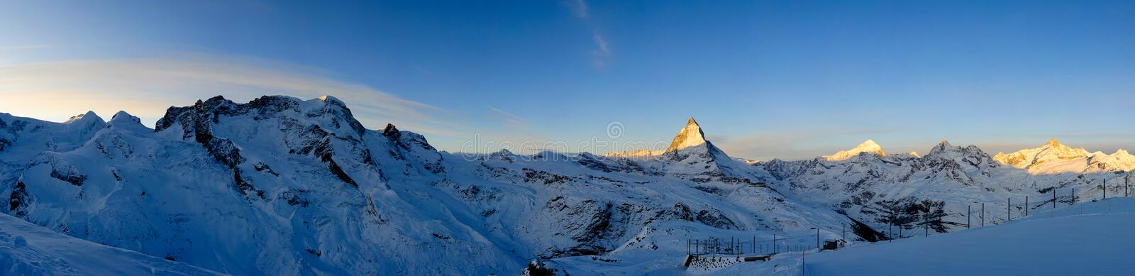 Panorama from Gornergrat at sunrise. Zermatt, Wallis, Switzerland stock image