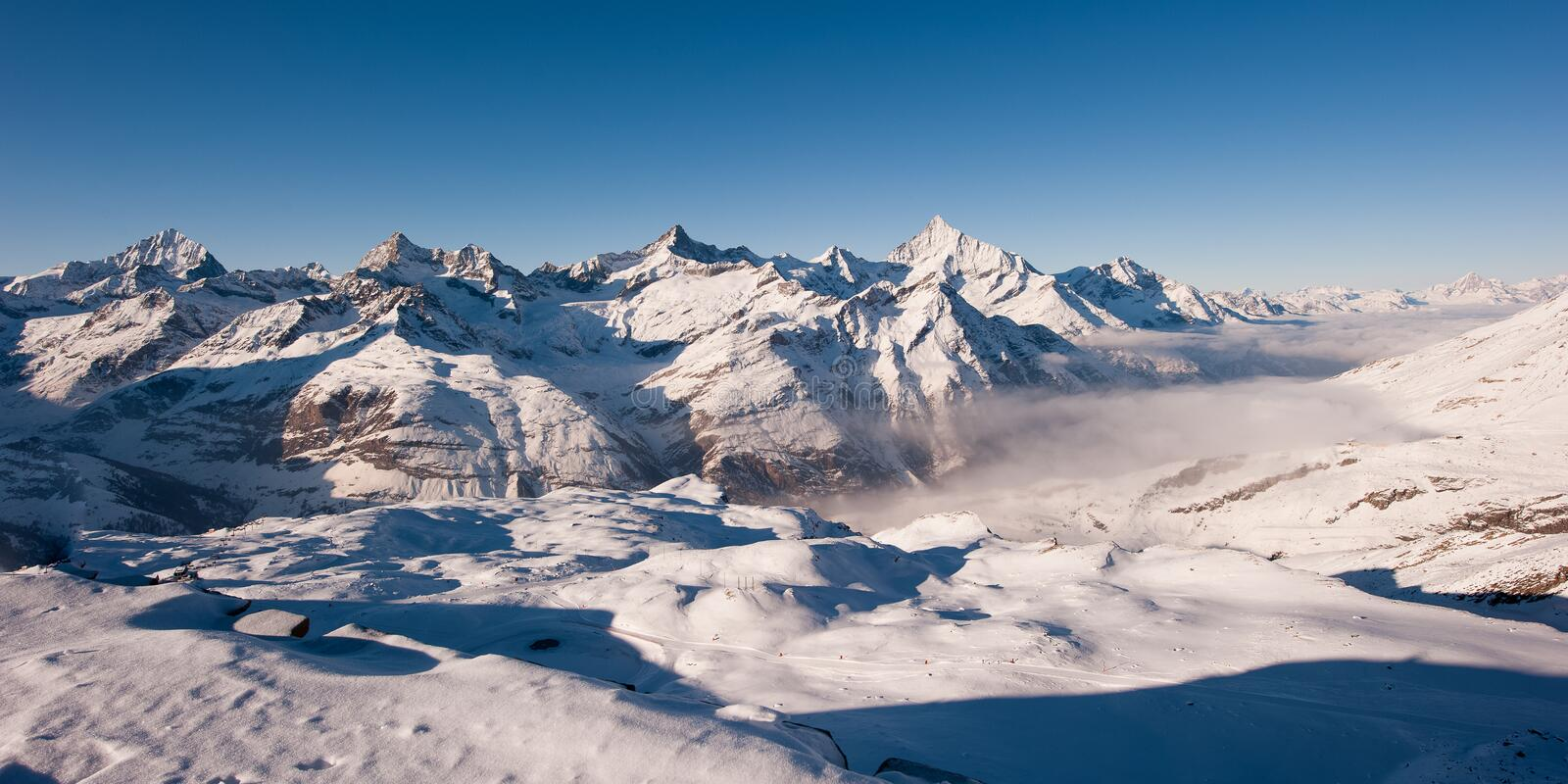 Panorama from gornergrat in winter. Panorama from Gornergrat above Zermatt with Dent Blance, Gabelhorn, Zinalrothorn and Weisshorn mountain peaks, Wallis royalty free stock photo