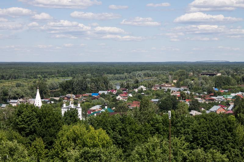 Panorama of Gorokhovets in Russia on a clear summer day. Beautiful panorama of Gorokhovets in Russia on a clear summer day with the horizon and blue sky stock images