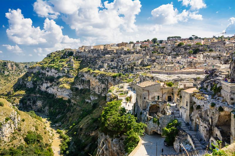 Panorama of the gravina with the ancient houses of Matera. The Panorama of the gravina with the ancient houses of Matera royalty free stock images