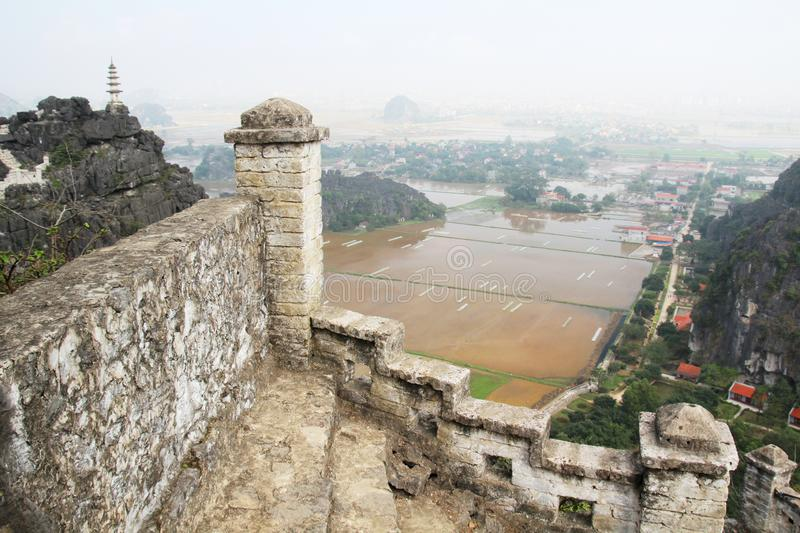 A panorama from Hang Mua, Ninh Binh, Vietnam. Hang Mua is a trek up with many of limestone steps worth efforts for impressive panoramic view of Tam Coc, Trang An stock images