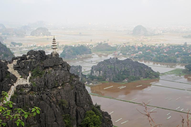 A panorama from Hang Mua, Ninh Binh, Vietnam. Hang Mua is a trek up with many of limestone steps worth efforts for impressive panoramic view of Tam Coc, Trang An royalty free stock photo