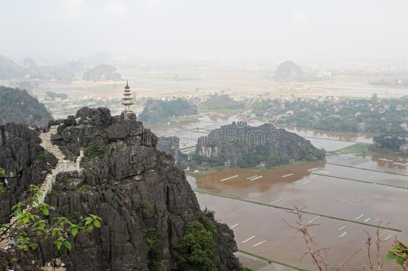 A panorama from Hang Mua, Ninh Binh, Vietnam. Hang Mua is a trek up with many of limestone steps worth efforts for impressive panoramic view of Tam Coc, Trang An stock photos