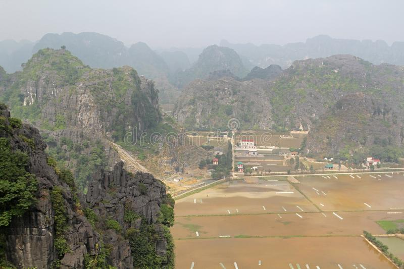 A panorama from Hang Mua, Ninh Binh, Vietnam. Hang Mua is a trek up with many of limestone steps worth efforts for impressive panoramic view of Tam Coc, Trang An stock image