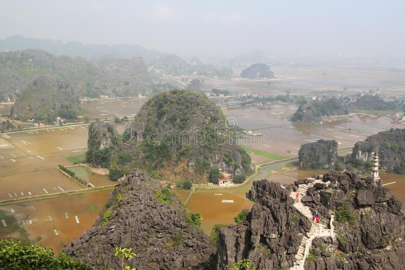 A panorama from Hang Mua, Ninh Binh, Vietnam. Hang Mua is a trek up with many of limestone steps worth efforts for impressive panoramic view of Tam Coc, Trang An royalty free stock photography