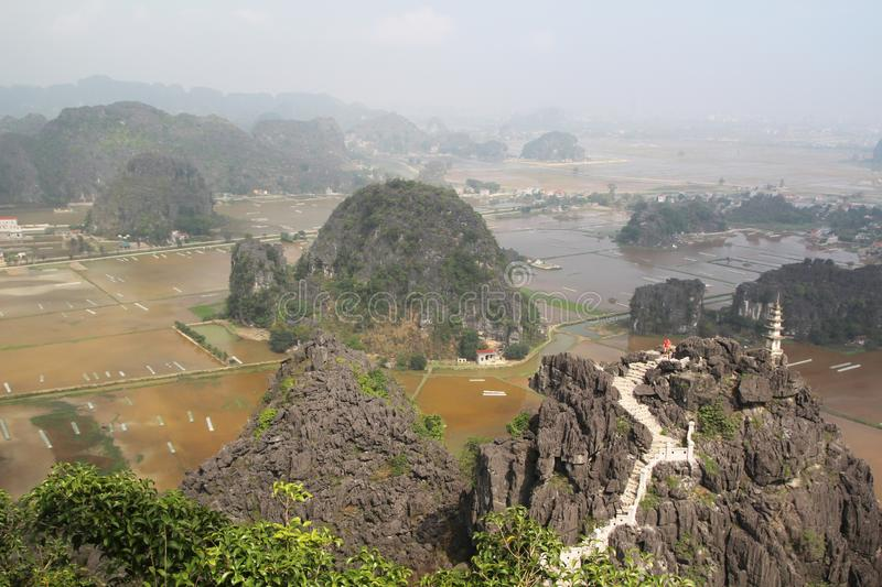 A panorama from Hang Mua, Ninh Binh, Vietnam. Hang Mua is a trek up with many of limestone steps worth efforts for impressive panoramic view of Tam Coc, Trang An stock photo