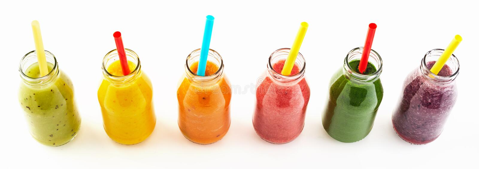 Panorama of healthy veggie and fruit smoothies stock photos
