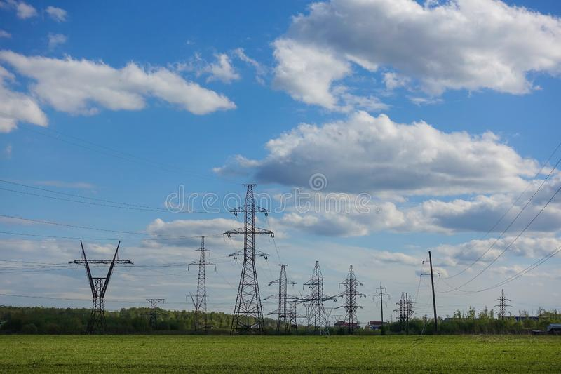 Panorama of high voltage substation. Distribution electrical power. Silhouettes of pylons and towers.  stock images